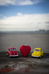 Toy cars and heart shape