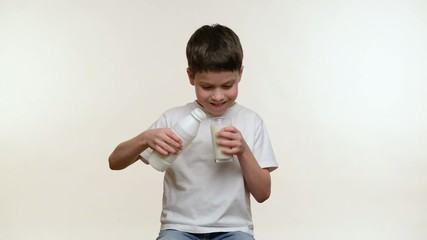 Boy drinking milk. White background