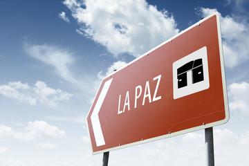 La Paz direction. Brown road sign.