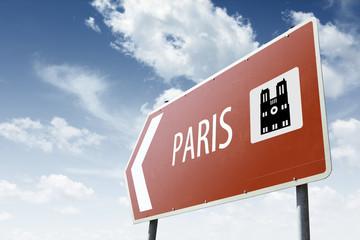 Paris direction. Brown road sign.