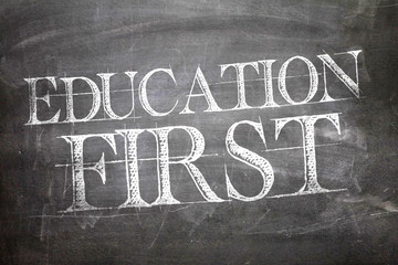 Education First written on blackboard