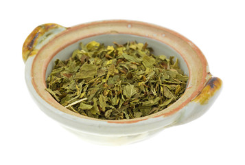 Fresh spearmint herb in a small dish