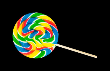 Single lollipop on a black background