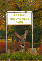 Let the nature heal you - billboard sign in front of the autumn