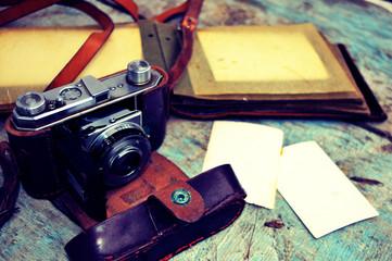 Old retro camera on vintage wooden background