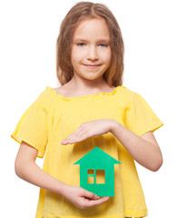 Girl holding a green house