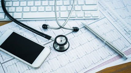 Stethoscope on cardiogram concept for heart care
