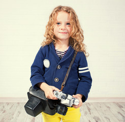 Little girl photographing