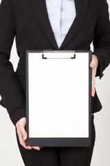 businesswoman showing blank paper sheet