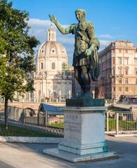 Statue of emperor Traiano and  Santa Maria di Loreto Church in R