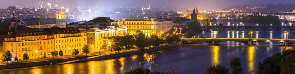 Night panorama view of the Vltava River and the bridges in Pragu