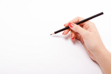Woman writing on white sheet