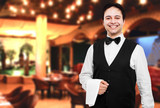 Young waiter at the restaurant