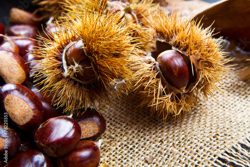 canvas print picture Chestnuts on an old board.