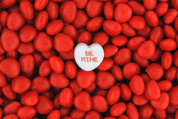 Be Mine Candy on Top of Small Valentine Candies