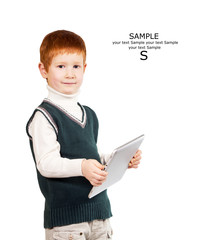Cute red haired child stands with a tablet PC. Isolated at the w