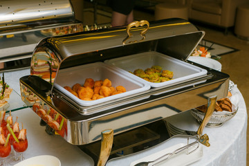 Catering - served table with nuggets and other hot snacks