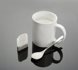 Cup, spoon and tea bag
