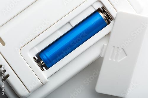 Leinwandbild Motiv Blue battery in the socket