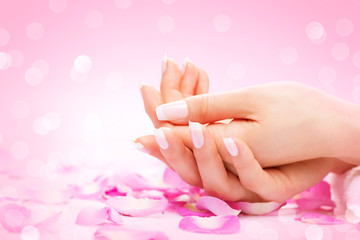 Hands spa. Manicured female hands, soft skin, beautiful nails