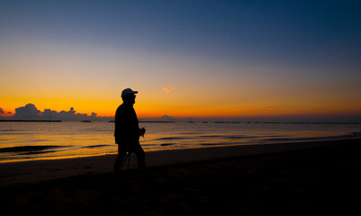 silhouette of a man walking on the sea