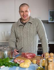 Man in his kitchen