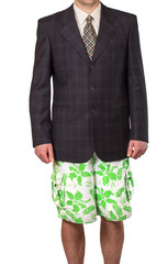 Businessman in suit jacket but in summer shorts isolated at the