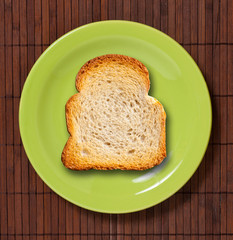 Toast on green plate.