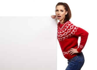 Beautiful young woman with white blank board