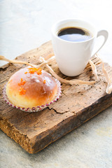 donuts and coffee on wooden background