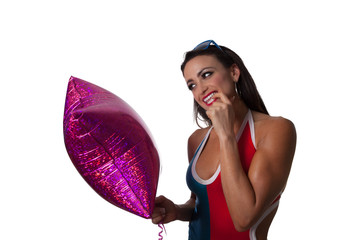 Young Pretty Latino Woman playing with a purple balloon