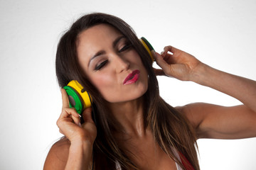 Young Latino Woman Listening to colorful DJ Style Headphones