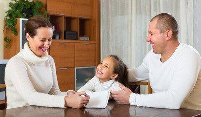 Smiling family with documents