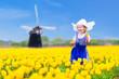 Beautiful dutch girl in tulip field in Holland