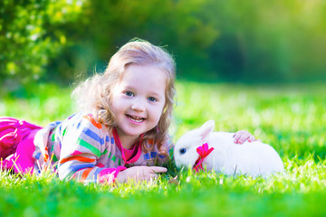 Sweet little girl and real rabbit