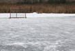 A ice hockey net on an outdoor pond rink..
