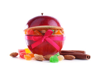 Red apple stuffed with dried fruits with cinnamon and almond