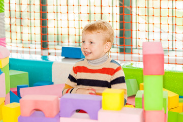 Little boy play construction set