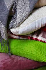 Pile of plaids and pillows, macro view