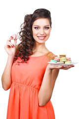 Young beautiful girl with tasty macaroon isolated
