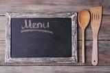 Blackboard menu on rustic wooden planks background