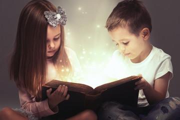 Small couple opened a magic book