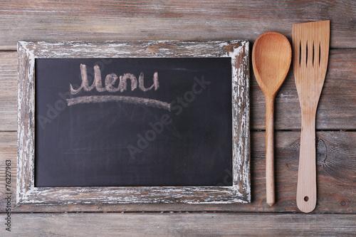 Blackboard menu on rustic wooden planks background - 76227963