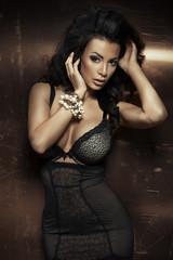 Sexy brunette woman posing in elegant lingerie,