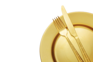 Golden knife and fork with plate