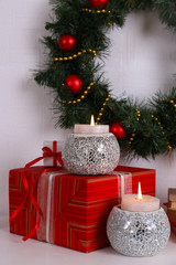 Christmas decoration with wreath, candles and present boxes