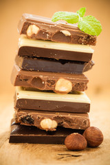 Stack of different sorts chocolate and hazelnuts