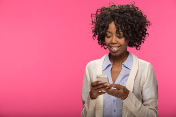 Young African American black woman texting on cellphone