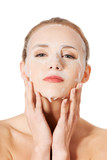 Beautiful woman with collagen mask. poster
