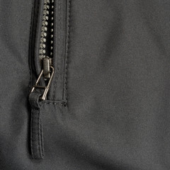 Black polyester fabric texture background open jacket zipper